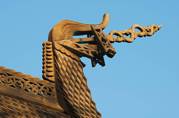 Dragon head decoration on medieval wooden Norwegian Stave Church stock photo