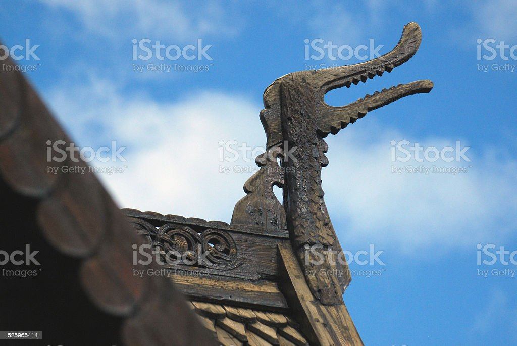 Dragon head on the wooden church of Lom, Norway stock photo