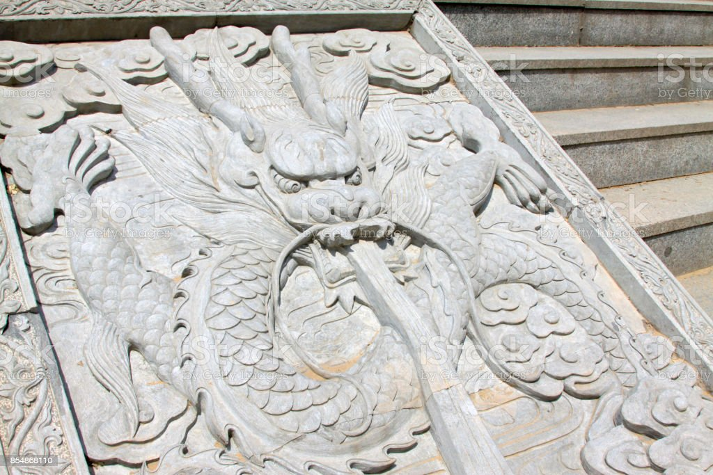 dragon king stone sculpture in a temple, north China stock photo
