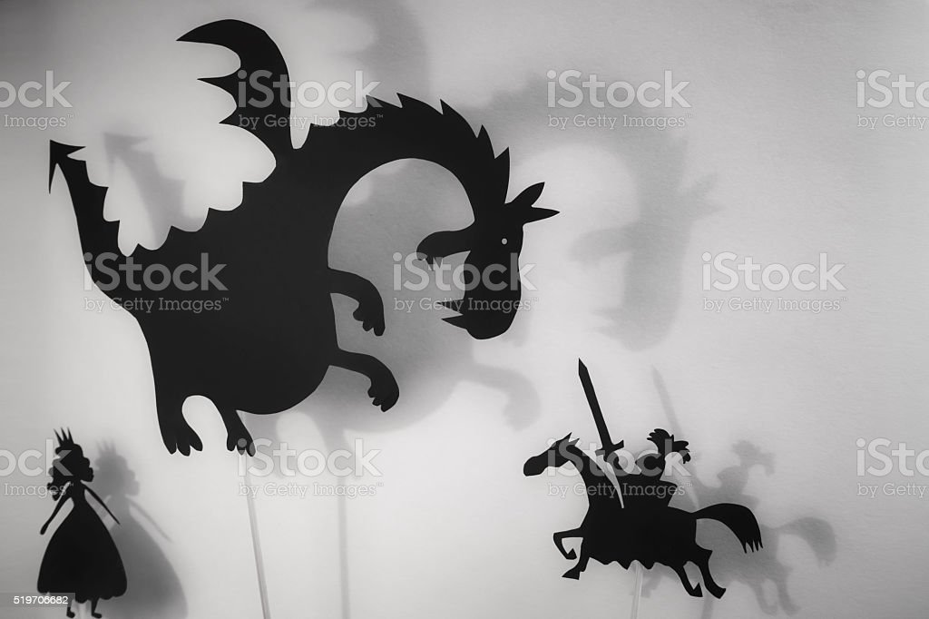 Dragon, Princess and Knight shadow puppets stock photo