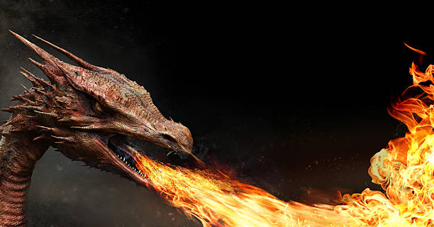 dragon spitting fire stock photo