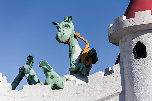 Dragon With Lute, Enchanted Forest Abandoned Amusement Park Figure stock photo