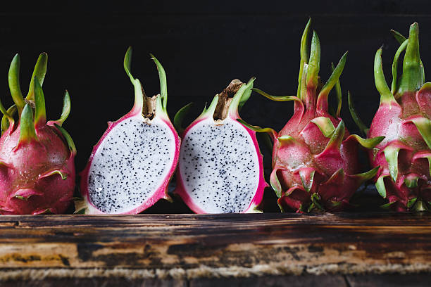 Dragonfruits Dragonfruits on the old wood pitaya stock pictures, royalty-free photos & images