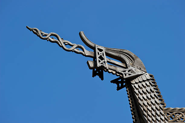 Dragonhead of Norwegian medieval wooden post and beam Stave Church stock photo