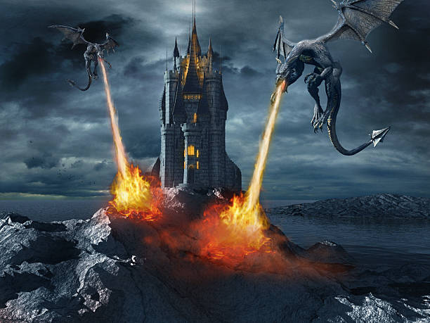 Dragons attacking the castle stock photo