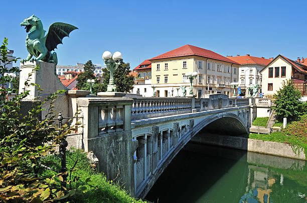 Dragon's bridge, Ljubljana, Slovenia Dragon's bridge and Ljubljanica river beneath, Ljubljana, Slovenia ljubljana stock pictures, royalty-free photos & images