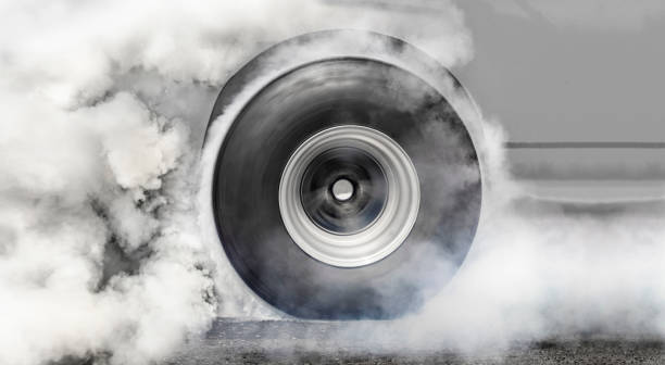 Dragster burns rubber off its tires for the race stock photo