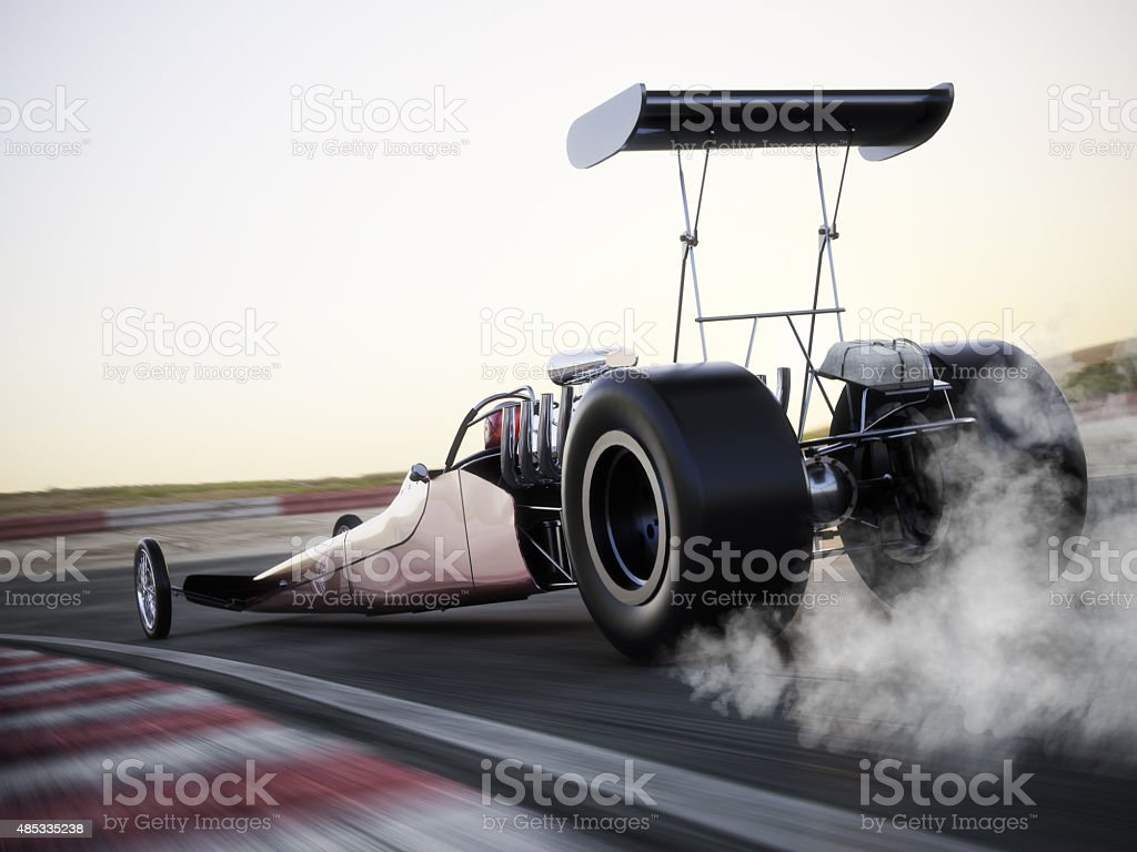 Dragster racing down the track with burnout stock photo