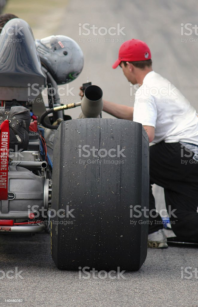 Dragster receiving service before the race stock photo