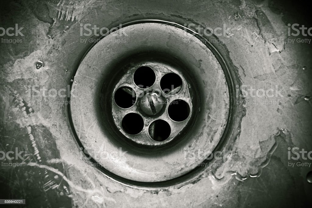 Drain hole in the kitchen sink close-up stock photo