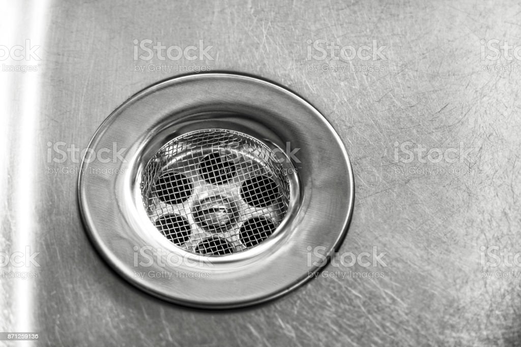 Drain in the sink with sieve stock photo
