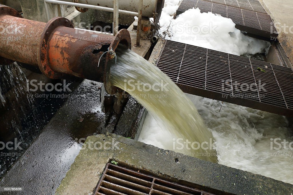 Drain make the foam on dirty water surface stock photo