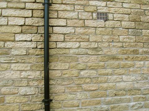 drain pipe on limestone wall
