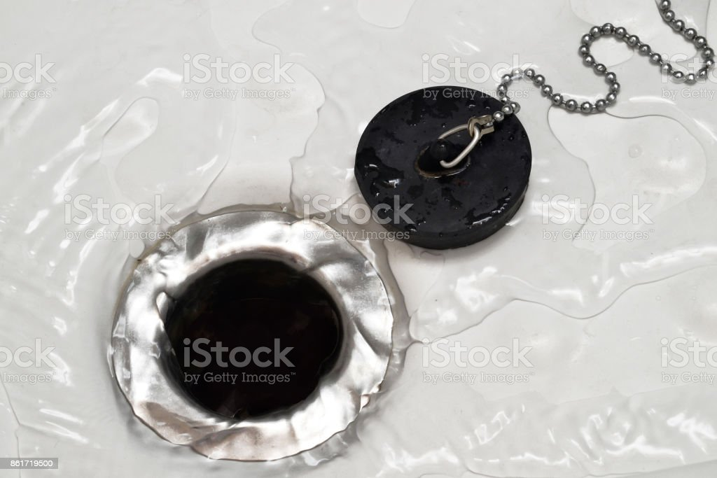 Drain the shower. stock photo