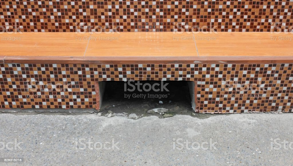 Drainage culvert hole system at pathway. stock photo