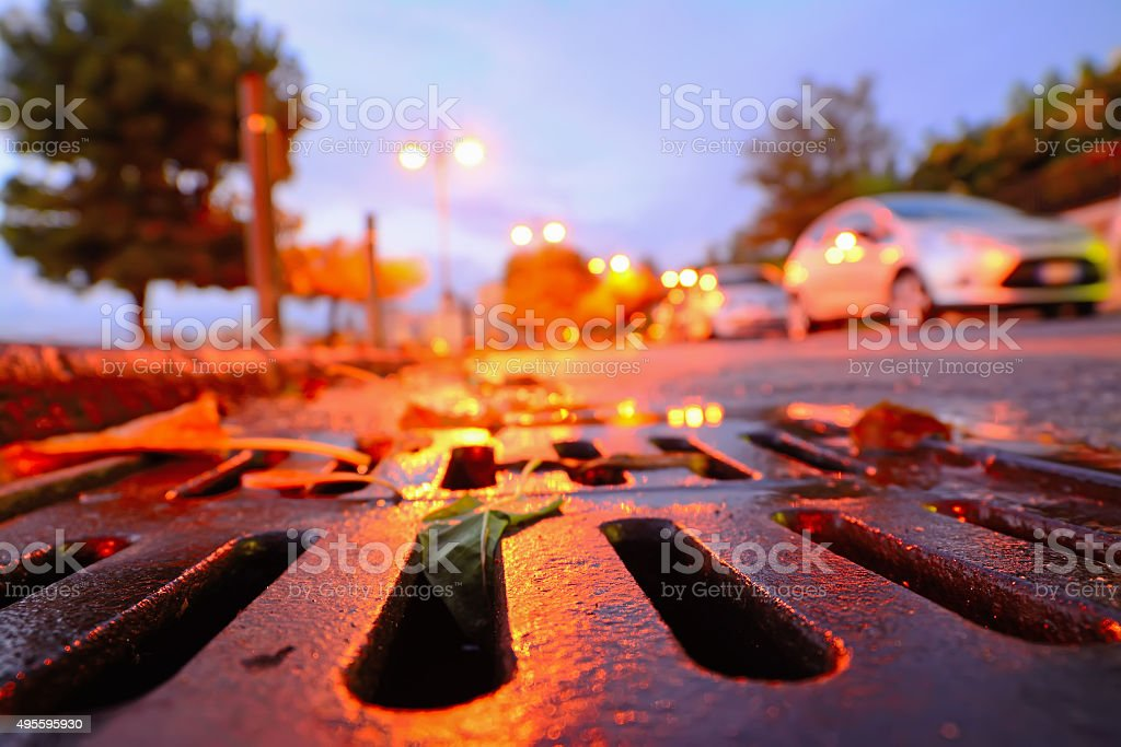 drainage sewer at sunset stock photo