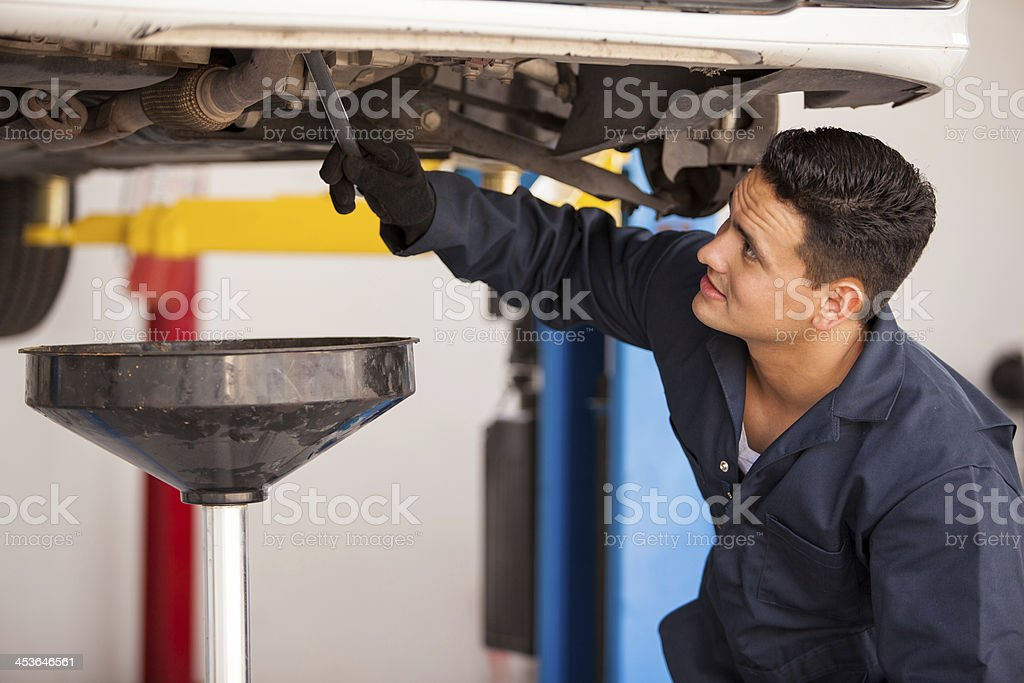 Draining down old engine oil stock photo