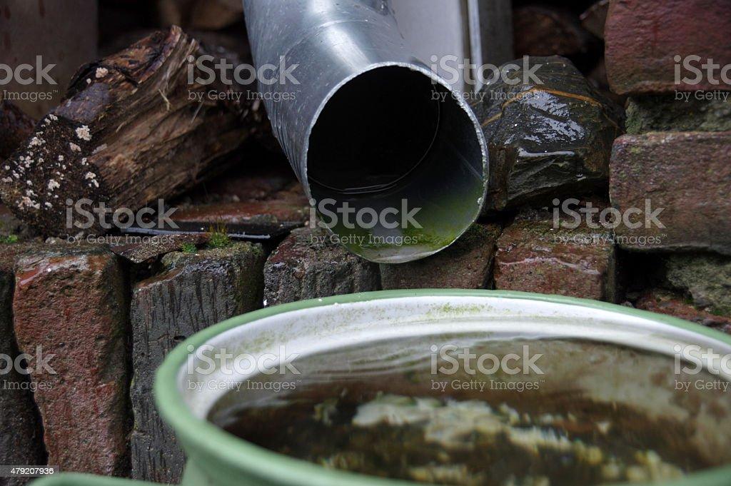 Drainpipe in the garden stock photo