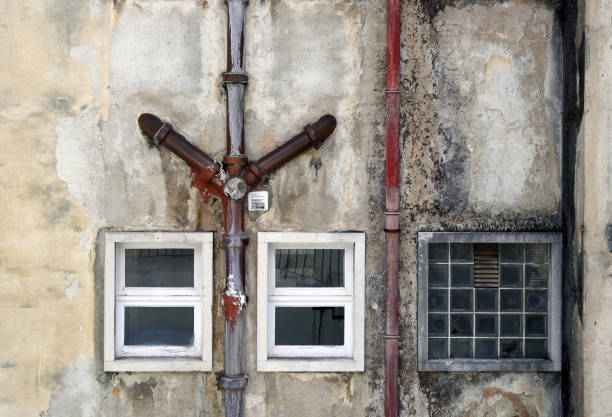 Drainpipes on building facade. stock photo