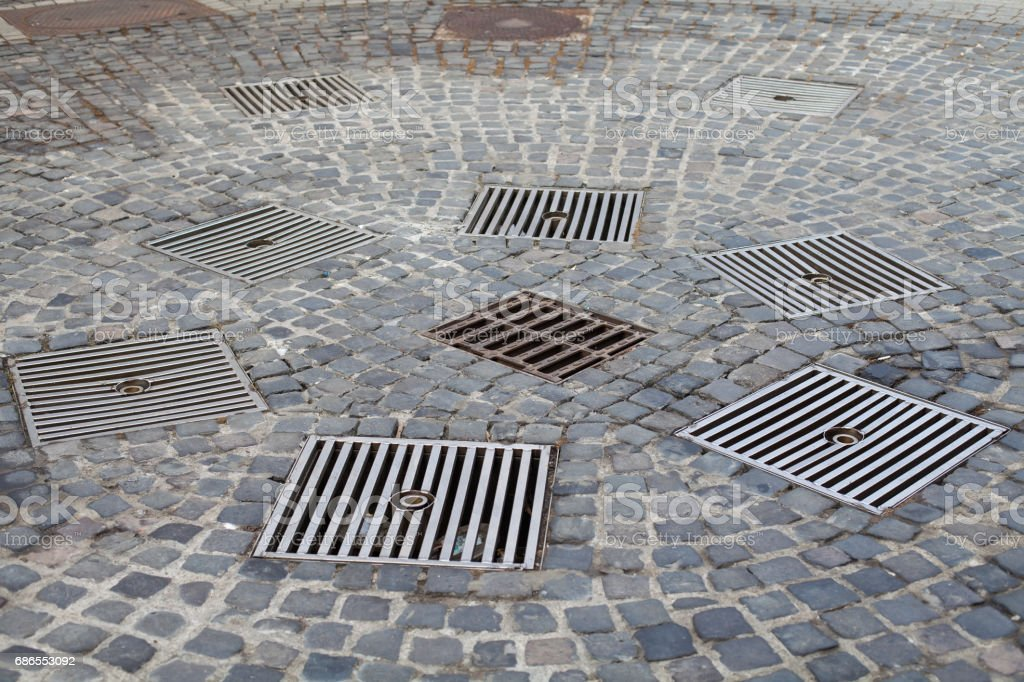 Drains in the city stock photo