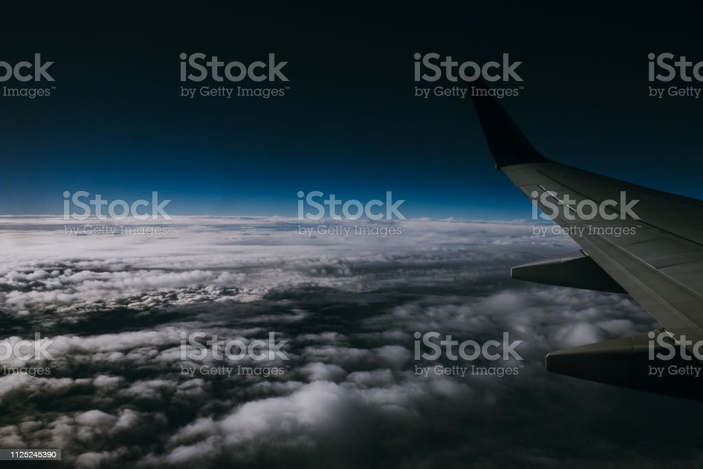 A dramatic airplane view on a cloud day at sundown stock photo