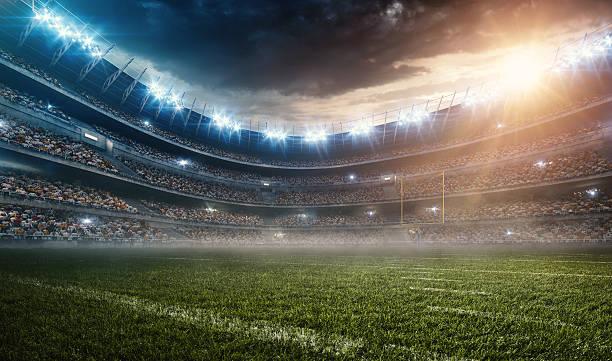 ドラマチックなアメリカンフットボールスタジアム - アメリカンフットボール ストックフォトと画像