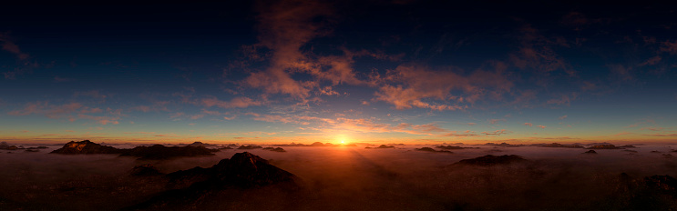 Digitally generated majestic and dramatic dusk/dawn above the clouds panorama.\n\n
