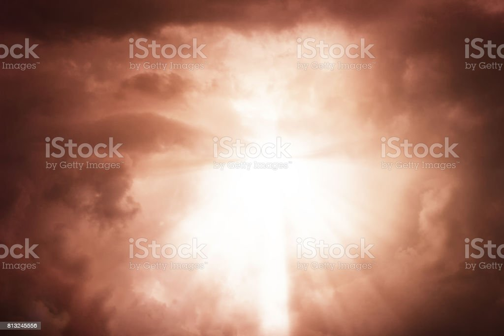Dramatic apocalyptic clouds background with light rays stock photo