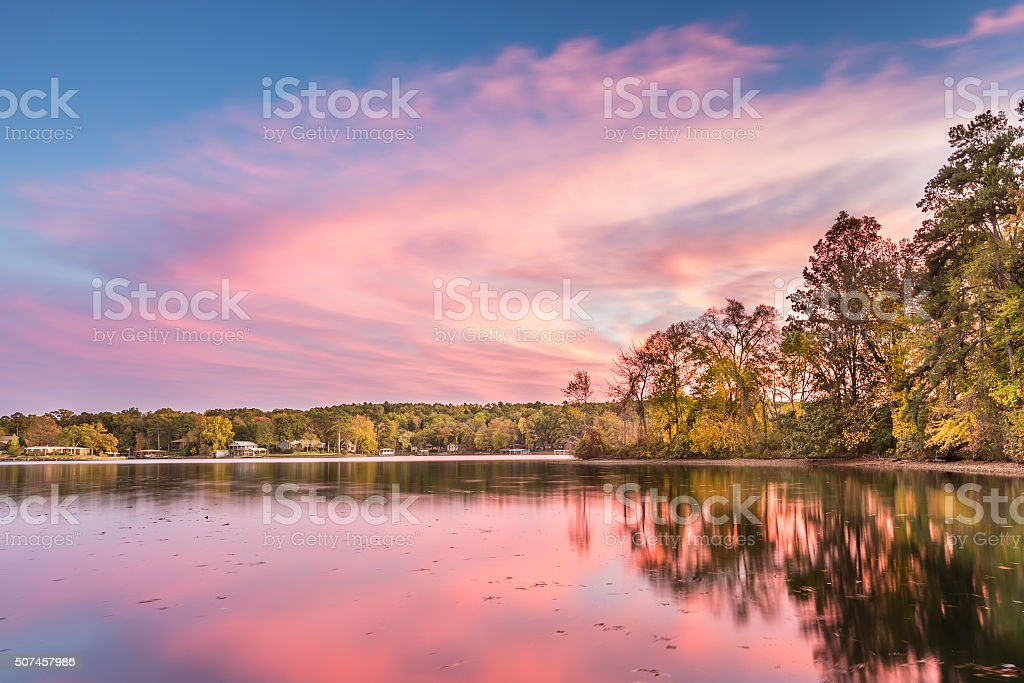 Dramatic Autumn sunset at Hamilton Lake in Arkansas stock photo