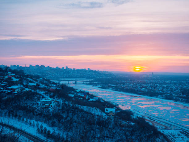 dramatic beautiful sunrise over the panorama of the city of Ufa at winter stock photo