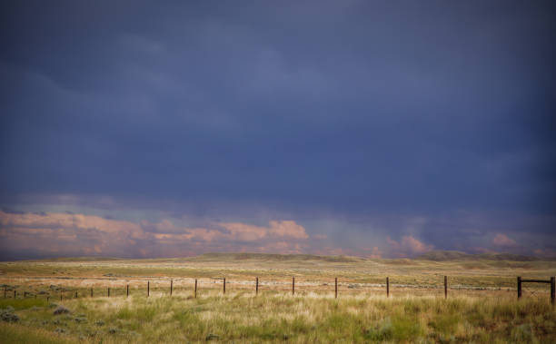 dramatic blue sky over pasture - montana western usa stock pictures, royalty-free photos & images