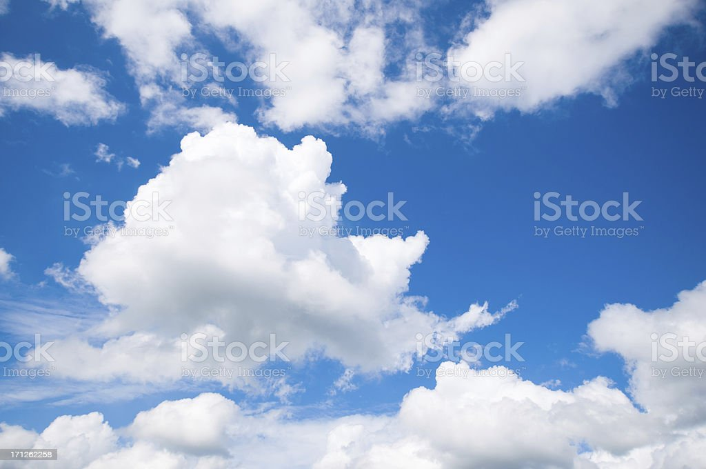 Dramatic blue sky with large fluffy clouds royalty-free stock photo
