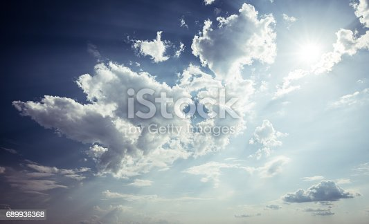 dramatic blue sky with sun