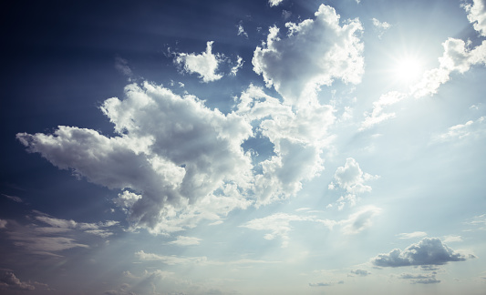 istock dramatic blue sky with sun 689936368