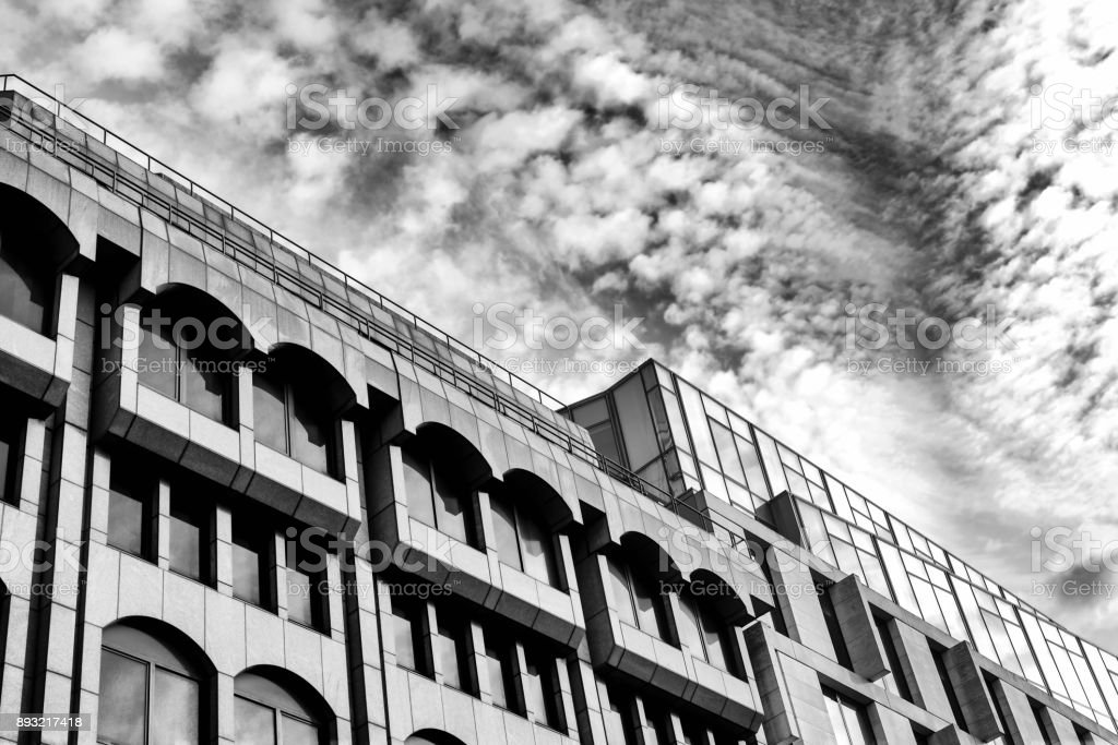 Dramatic Building with Cloudy Sky stock photo