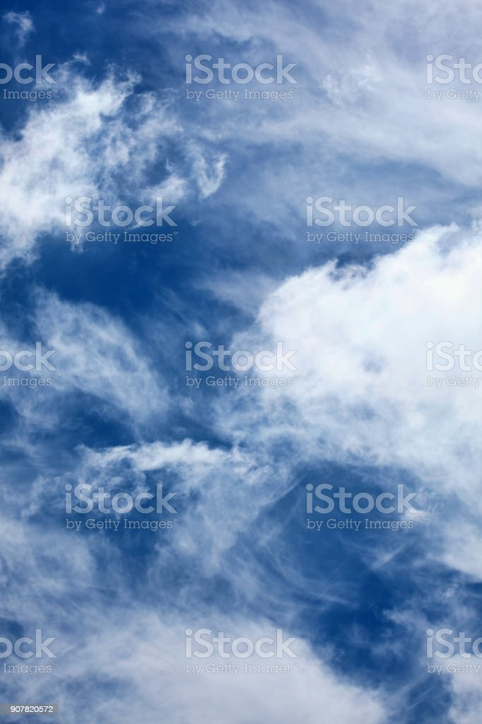 dramatic cirrus and cumulus clouds stock photo