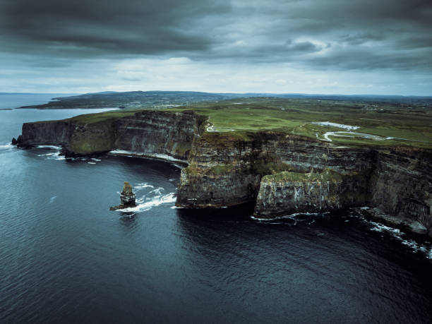 Dramatic Cliffs of Moher Ireland Aerial View Areal view towards the beautiful and famous Cliffs of Moher under windy dramatic skyscape. Burren Region, County Clare, Ireland cliffs of moher stock pictures, royalty-free photos & images