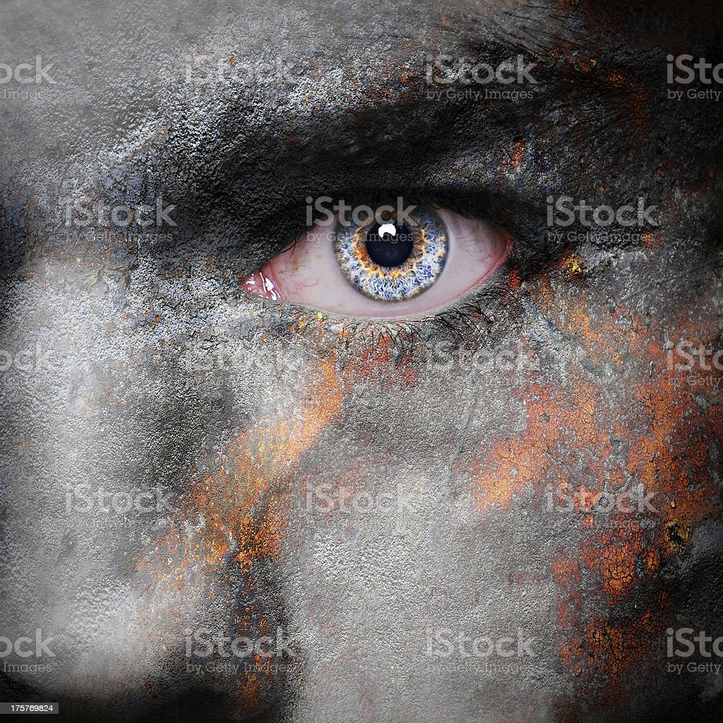 Dramatic close-up of a vampire's face turning to ashes royalty-free stock photo