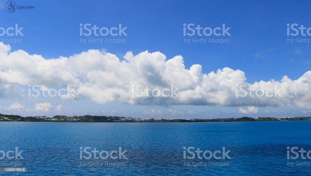 Dramatic Cloud Over an Island stock photo