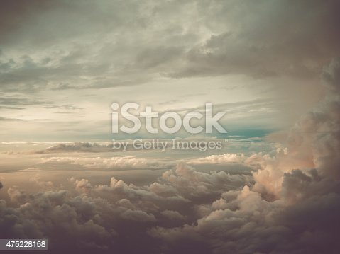 Cluster of clouds with gloomy colors and sunshine