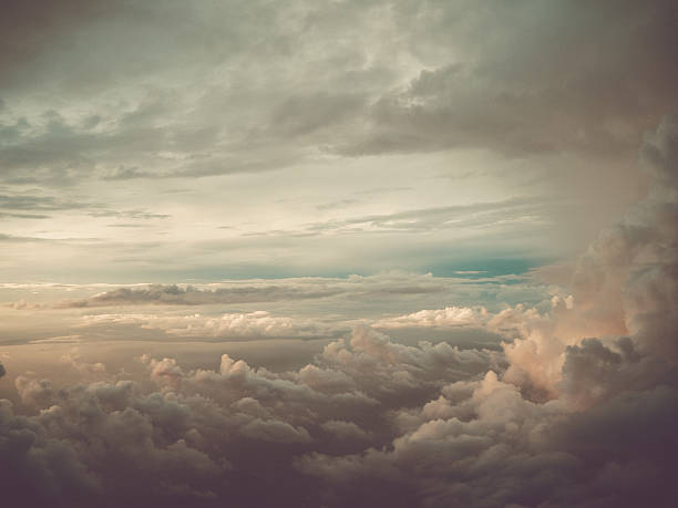 Dramatic Cloud with Sunshine Cluster of clouds with gloomy colors and sunshine atmospheric mood stock pictures, royalty-free photos & images