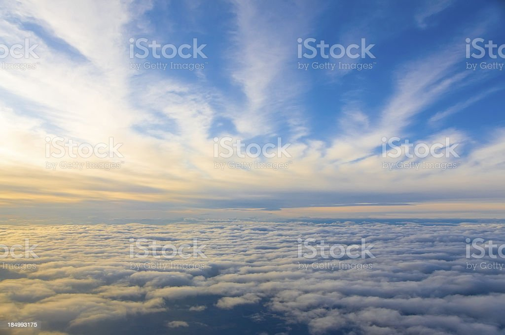 Dramatic Clouds above and below on Sunset stock photo
