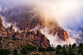 Dramatic Clouds and Red Rock Canyons in Zion - Scenic landscape in Zion National Park after a clearing storm.  Utah, USA.