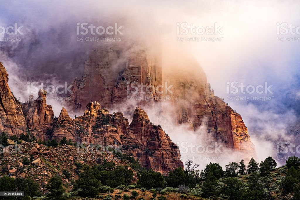 Dramatic Clouds and Red Rock Canyons in Zion stock photo