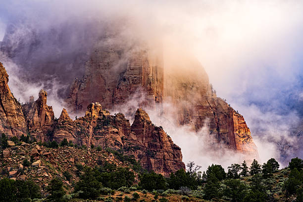 Dramatic Clouds and Red Rock Canyons in Zion Dramatic Clouds and Red Rock Canyons in Zion - Scenic landscape in Zion National Park after a clearing storm.  Utah, USA. zion national park stock pictures, royalty-free photos & images