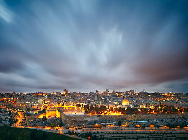 dramatic clouds over jerusalem old city, israel - jerusalem stock-fotos und bilder
