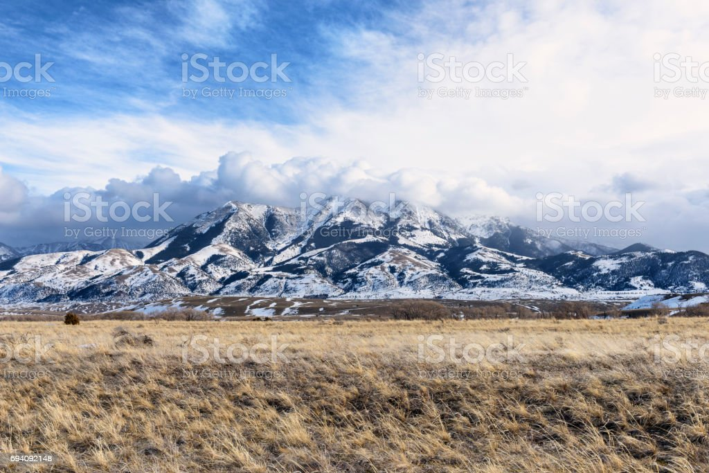Dramatic Clouds Over Montana Mountains in Winter stock photo