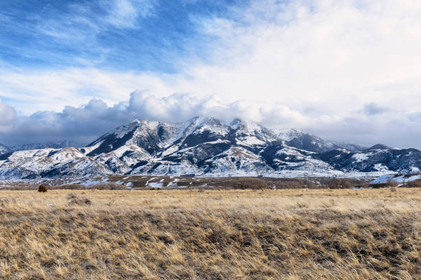 dramatic clouds over montana mountains in winter - montana western usa stock pictures, royalty-free photos & images