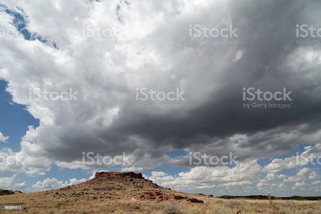 Dramatic clouds over pueblo ruin royalty-free stock photo