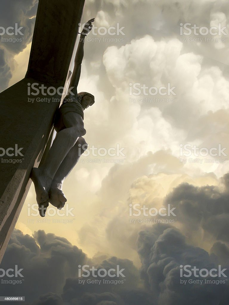 Dramatic Clouds with Jesus On the Cross Represents Crucifixion stock photo